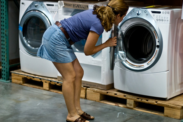 woman looking at different dryers
