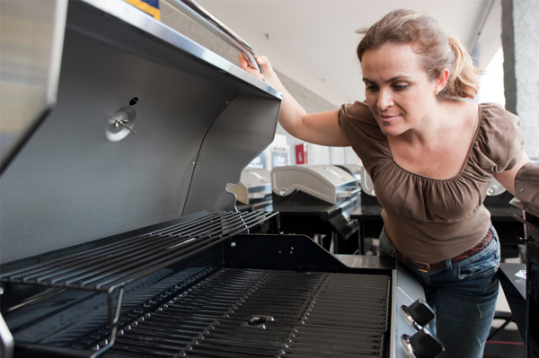 Woman shopping for grills