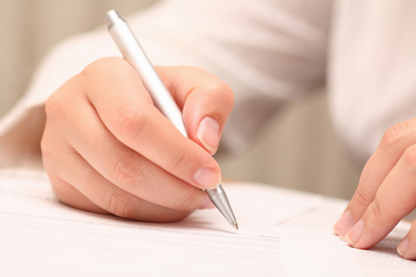 Woman signing contract