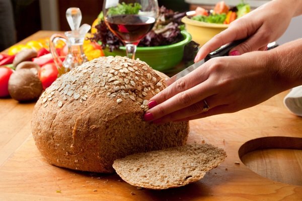 Woman slicing homemade bread