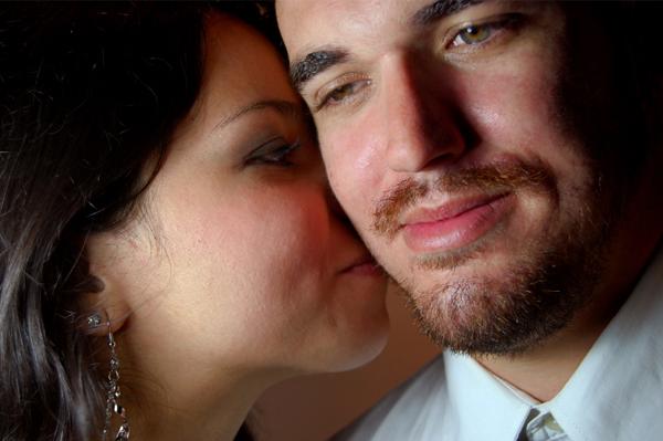 Woman smelling boyfriend