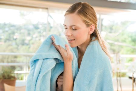 Woman smelling fresh linen