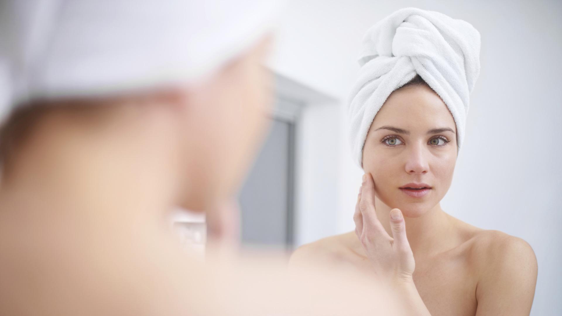 Woman spot testing beauty product