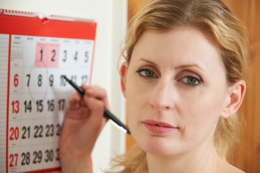 woman staring at calendar