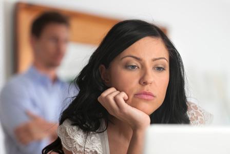 Woman staring at computer screen