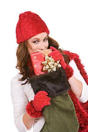 Woman opening Christmas stocking