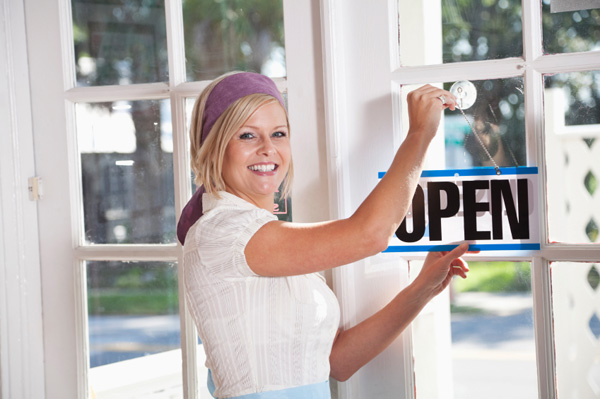 Woman opening store