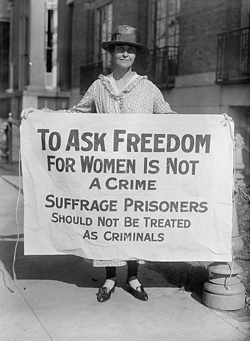 Woman holding suffrage sign