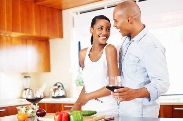 Woman cooking boyfriend dinner