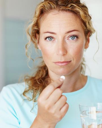 Woman taking OTC drugs