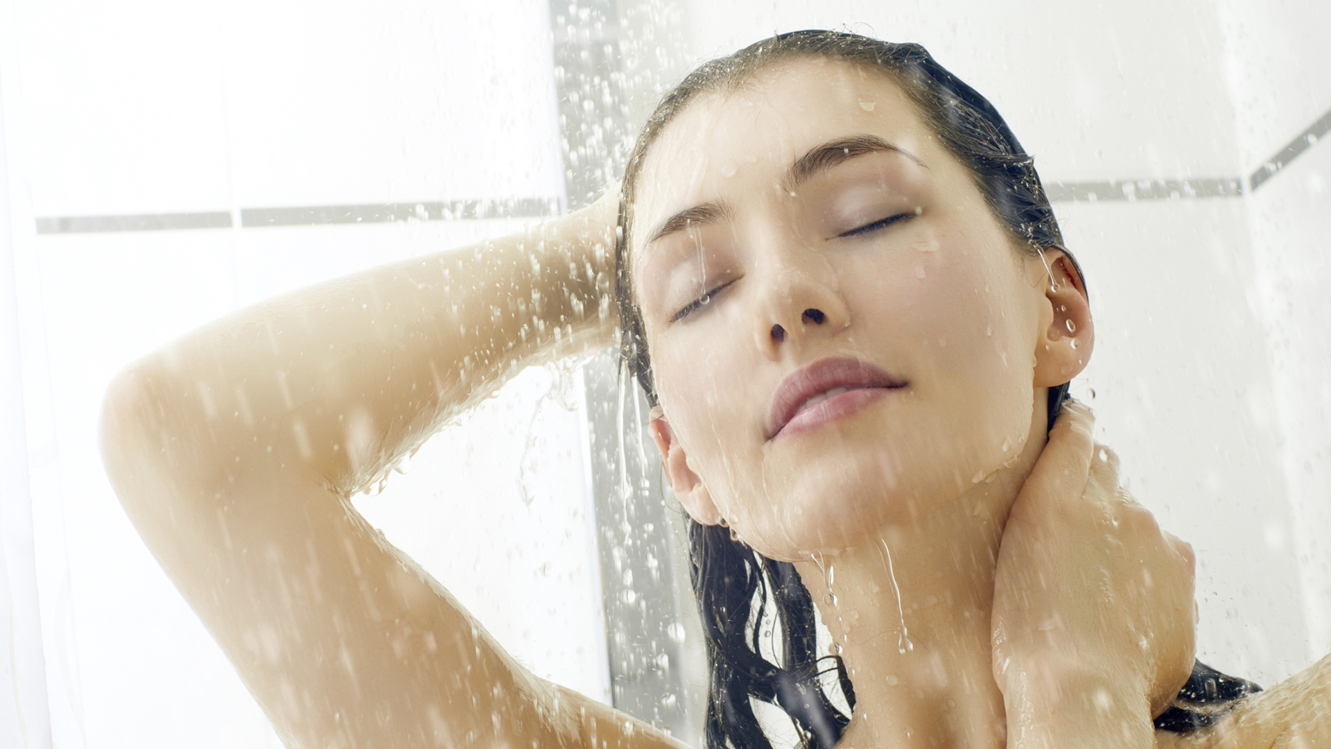 Woman taking shower | Sheknows.com