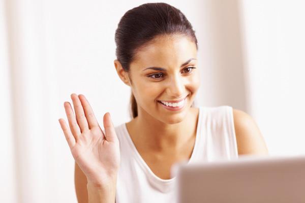 Woman talking to friends on webcam