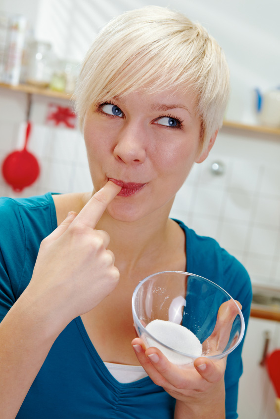 Woman tasting salt or sugar