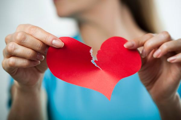 Woman tearing heart