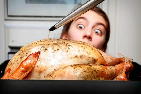 Woman tempted by Thanksgiving turkey