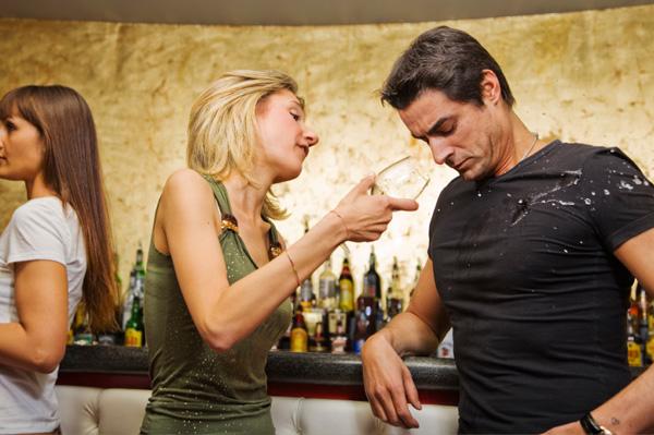 Woman throwing drink at ex boyfriend