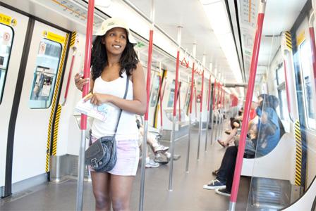Tourist on train in Hong Kong