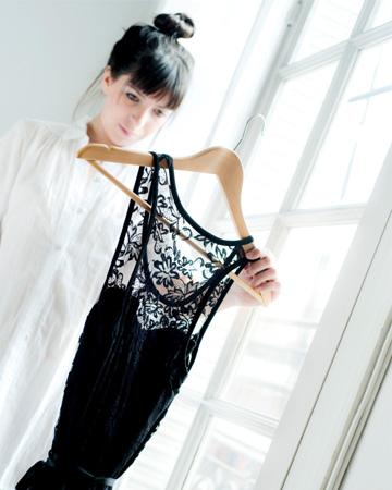 Woman trying on black dress