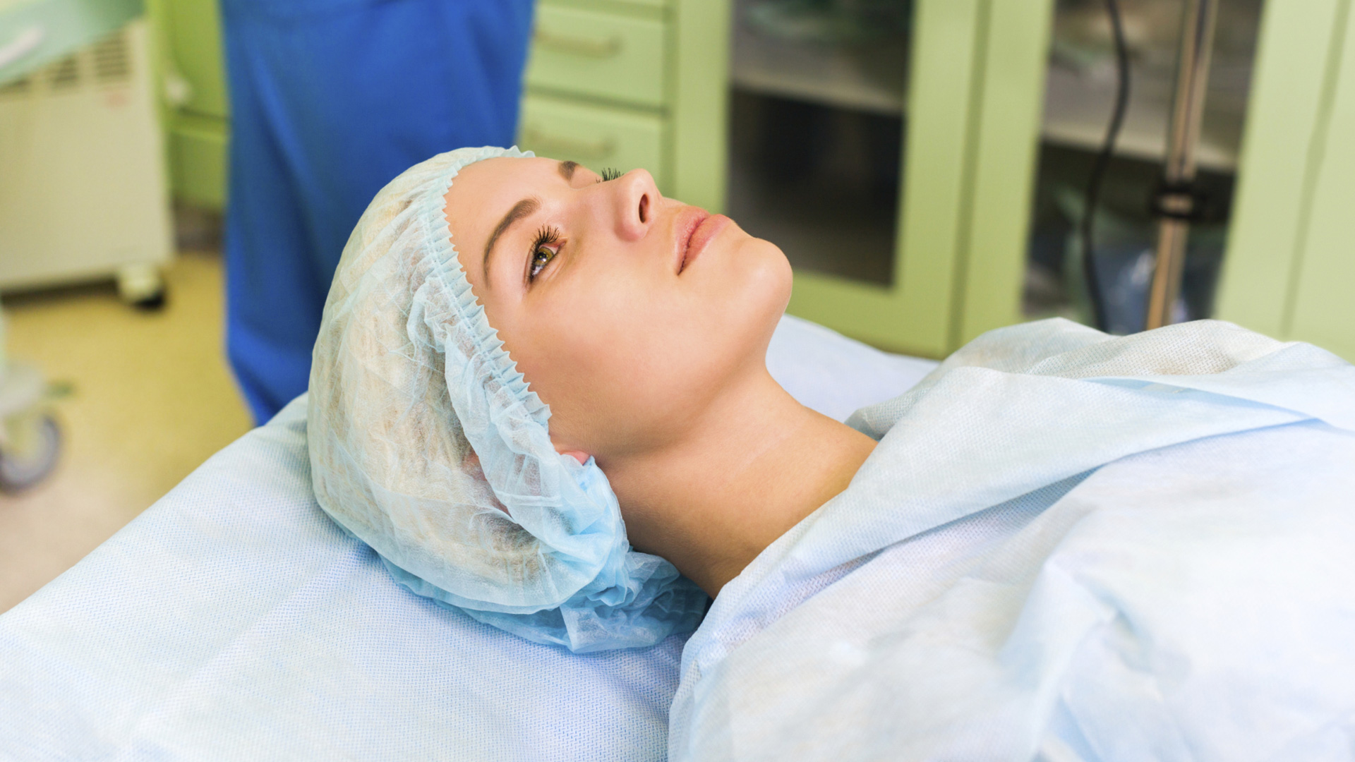 Woman undergoing operation