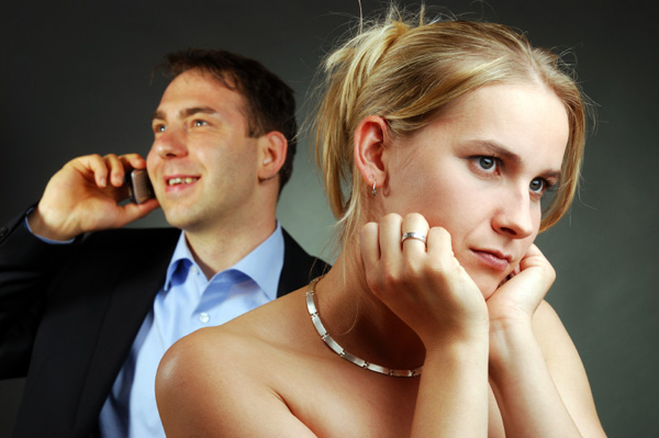 Woman upset by boyfriend on the phone
