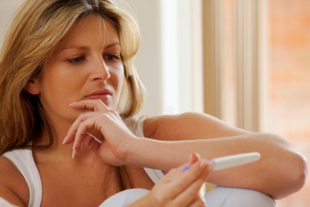 Woman disappointed with negative pregnancy test