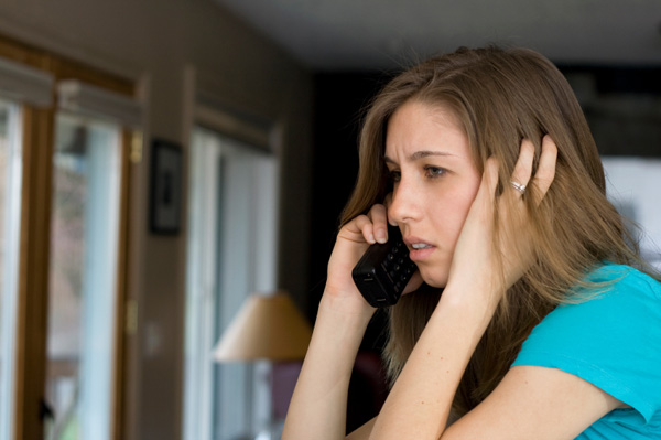 Woman on upsetting phone call