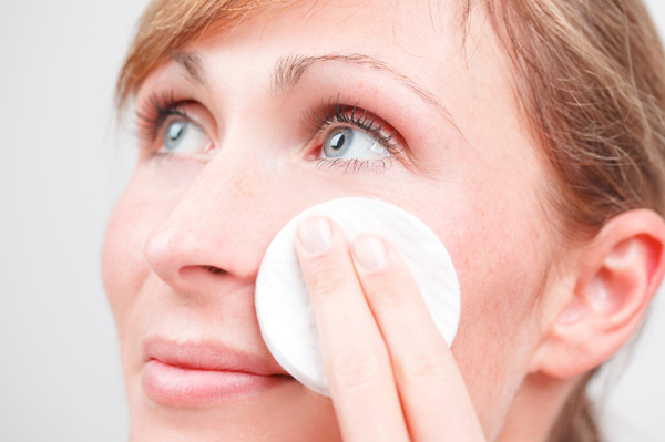 Woman using cleansing oils