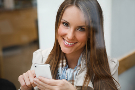Woman using iPhone to plan date