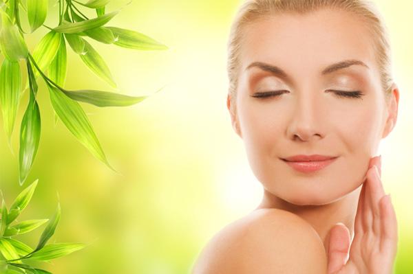 Woman using organic beauty cream
