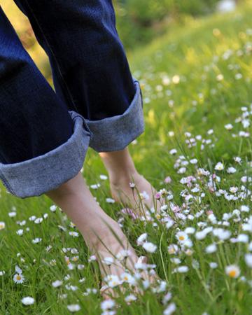 Woman walking barefoot