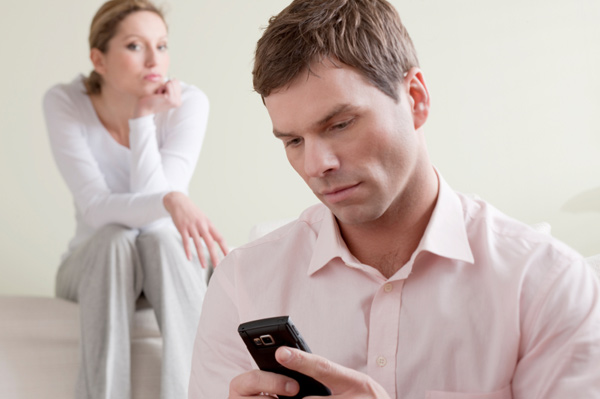 Woman eyeing boyfriend on the phone