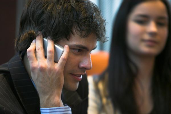 Woman watching boyfriend on phone