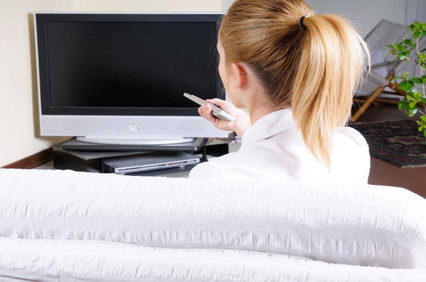 woman-watching-flatscreen-tv