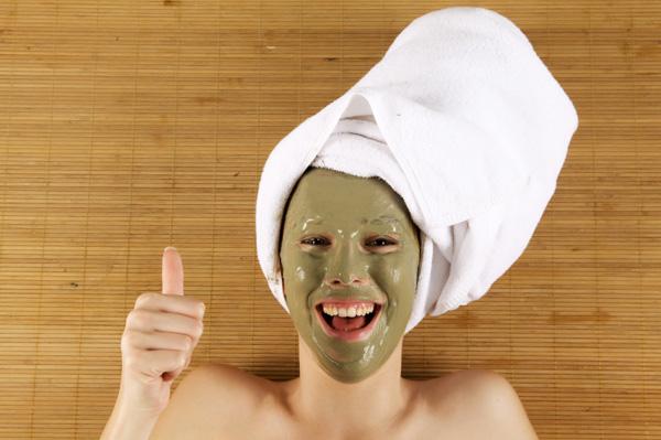 Woman wearing green mask