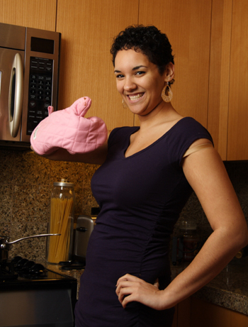 Woman wearing oven mitt