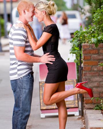 Woman wearing tight black dress on date
