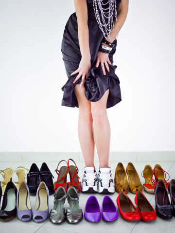 Woman with a variety of shoes