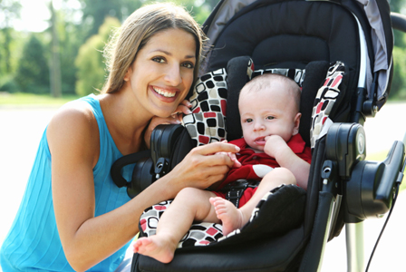 Woman with baby in a stroller
