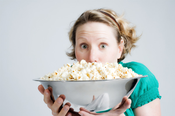 Woman with popcorn bowl