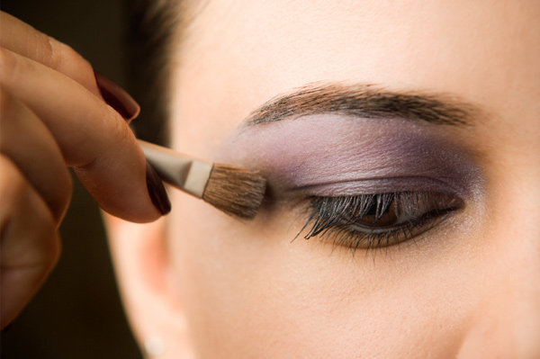 Woman with brown eyes and purple eyeshadow