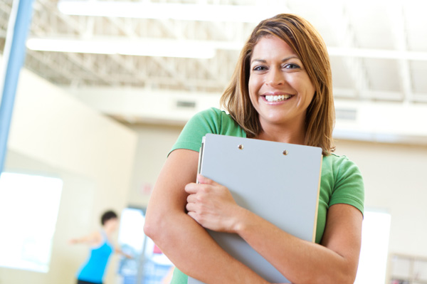 Woman with fitness binder