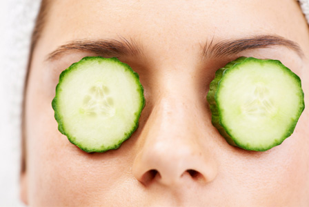 Woman with cucumbers on eyes