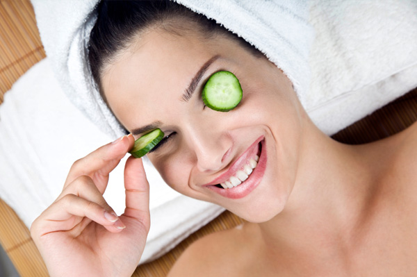 Woman with cucumbers on the face