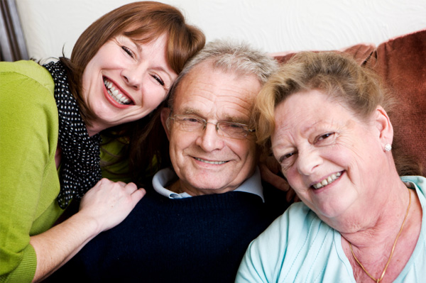 Woman with elderly parents