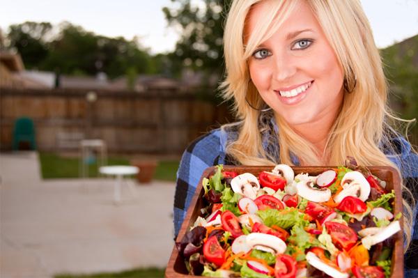 Woman with farmer's market salad