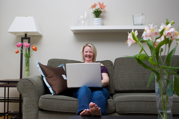 Woman with flowers on computer
