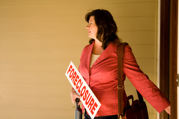 Woman with Foreclosure Sign