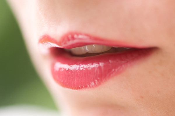 Woman with glossy lips
