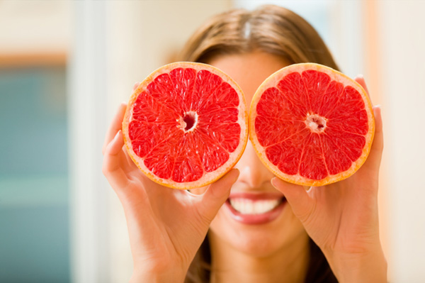 Woman with grapefruit