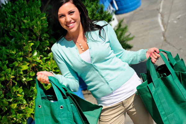 Woman with Green Shopping Bags